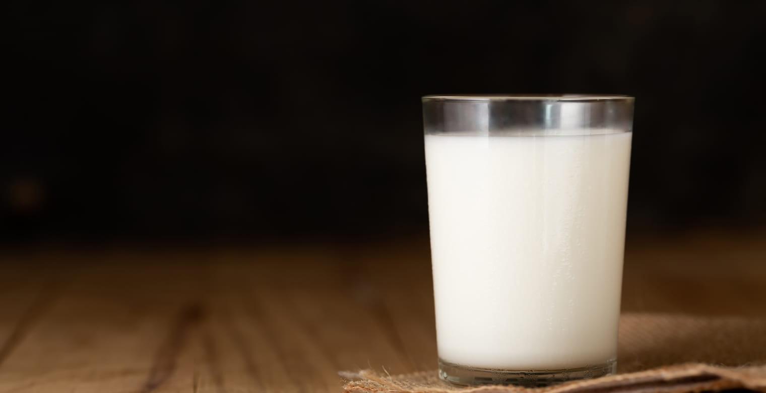 glass of milk against